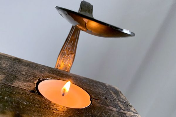 Woodern handmade oil burner with silver spoon and flame