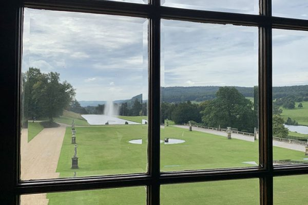 Chatsworth House looking through a window into the garden and water fountain